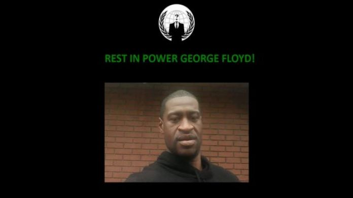 """A black page shows the anonymous logo, a photo of George Floyd, and the message """"rest in power""""."""
