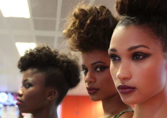 Three models pose