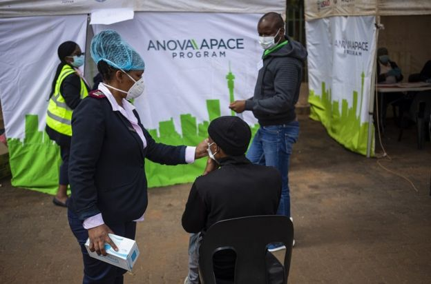 Medical staff prepare to test another person for Covid-19 Coronavirus at a reutine testing station on day 13 of the 21 day national lockdown following President Cyril Ramaphosa declaration of a National Disaster in Johannesburg, South Africa