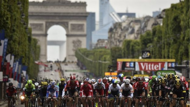 Cyclists in the Tour de France head down the Champs Elysees in Paris