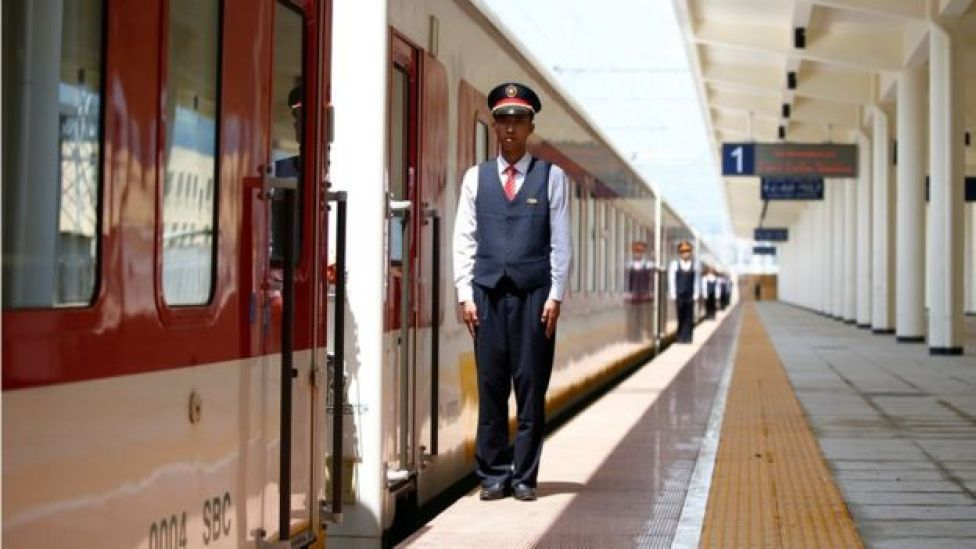 Chinese engineers stand in a line near a train at Furi train station near Addis Ababa, Ethiopia - Saturday 24 September 2016