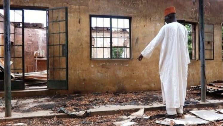 A staff inspects on August 6, 2013 a burnt student hostel in the Government Secondary School of Mamudo in northeast Nigerian Yobe state where Boko Haram gunmen launched gun and explosives attacks on student hostels on July 6, 2013, killing 41 students and a teacher