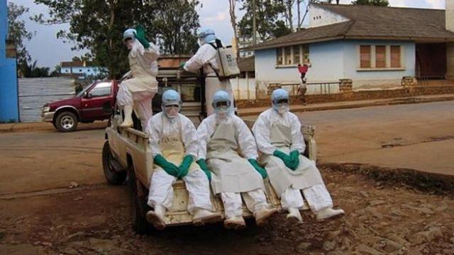 Personnel in hazard suits