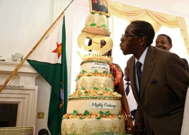 Zimbabwean President Robert Mugabe blowing out cake candles, Harare, Zimbabwe - Monday 22 February 2016