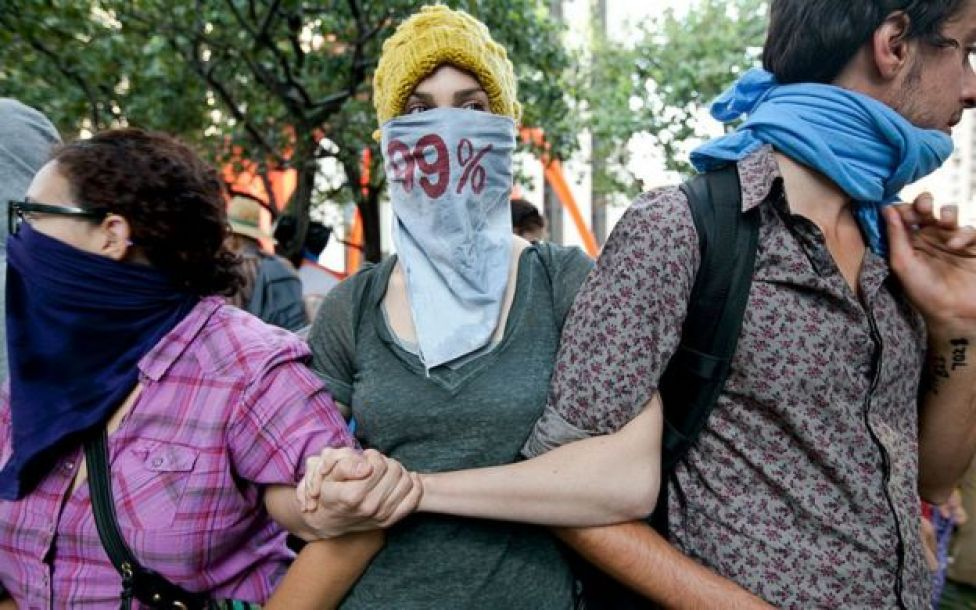 Protesters from Occupy LA in a rally in 2011. Sarah Mason, in a grey top, would later be featured on the cover of Time Magazine's Person of the Year.