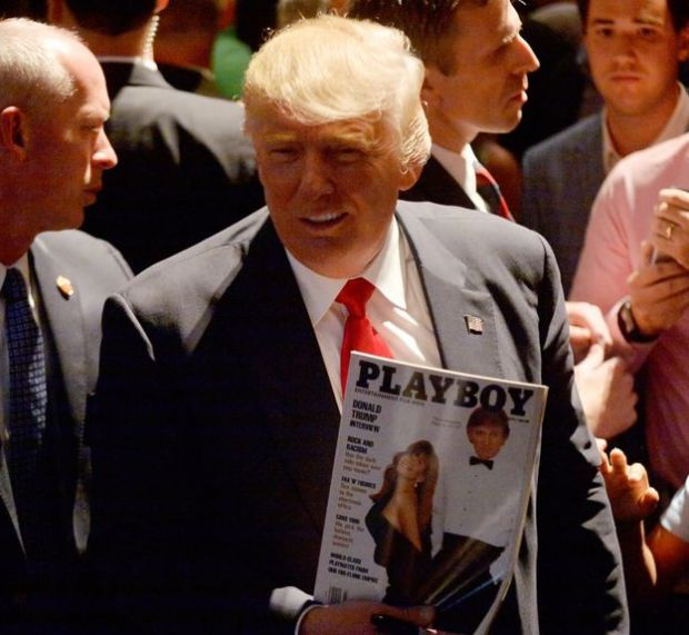Donald Trump carrying a Playboy magazine with himself on the cover at a campaign event in 2016