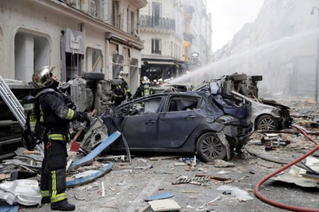 Firefighters tackle the blaze in Paris, 12 January