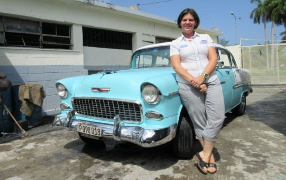 Nidialys with one of her classic cars