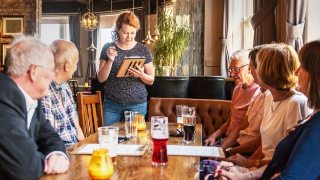 Group of people place a food order in a pub
