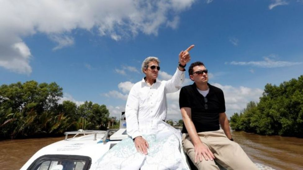 John Kerry, left, with historian Edward Miller, travelling along the Mekong Delta in Vietnam