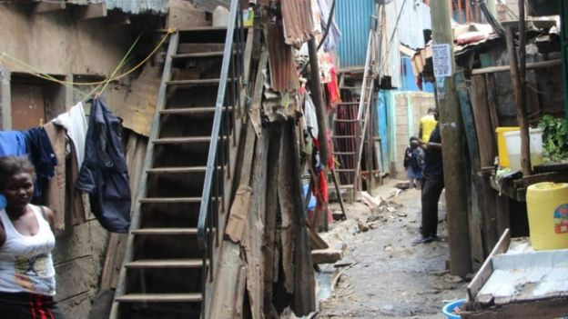 A woman standing outside her home in the Mukuru slum
