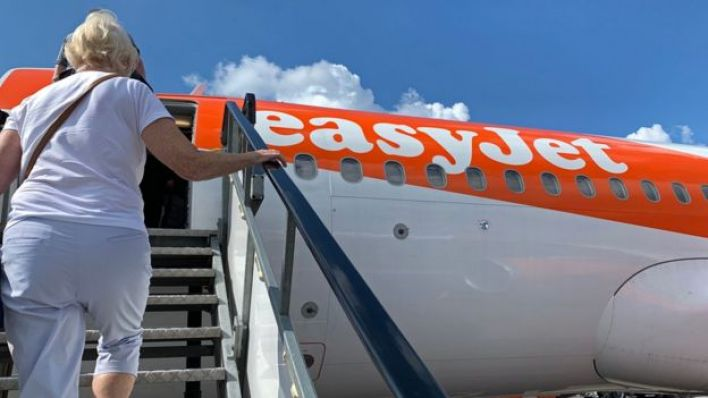 Passenger boards an EasyJet domestic flight at an airport in the United Kingdom on June 15, 2020