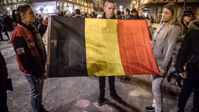 People gather and light candles at the Place de la Bourse during a vigil to pay tribute to the victims of the attacks in Brussels, Belgium. 22 March 2016