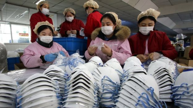 Workers make face masks in China