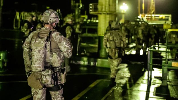 Royal Marines prepare to disembark Grace 1