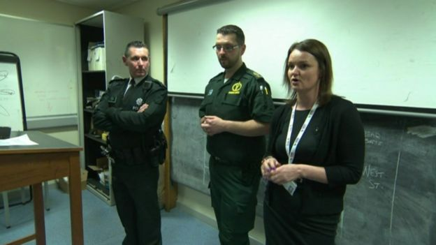 The Multi-Agency Triage Team, or MATT, briefing officers before their shift
