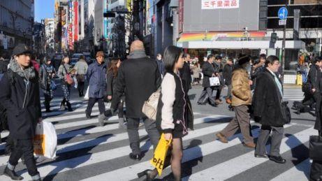 People walk across the street in Japan