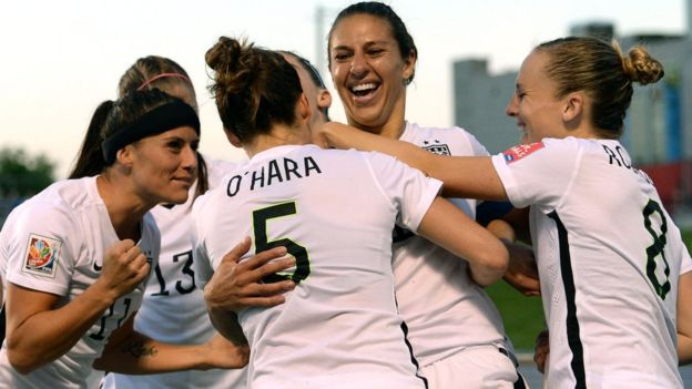 Carli Lloyd (number 10) celebrates a goal in the World Cup