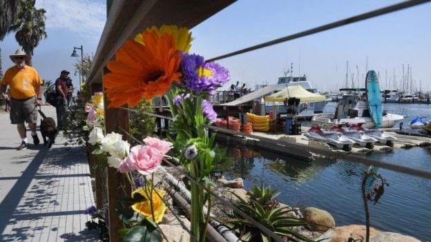 People have left flowers at the dock where the Conception is based