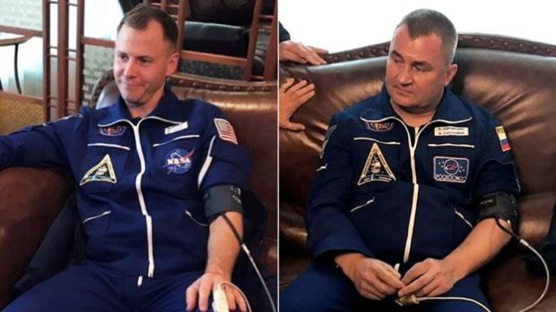 US astronaut Nick Hague and cosmonaut Alexey Ovchinin after landing safely following an incident with their Soyuz rocket, 11 October 2018