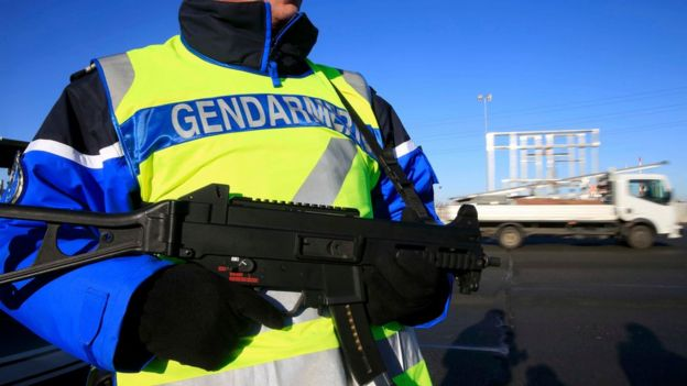 An armed French gendarme - one of a group checking vehicles and verifying the identity of travellers on the A2 motorway between Paris and Brussels, 25 January 2016.