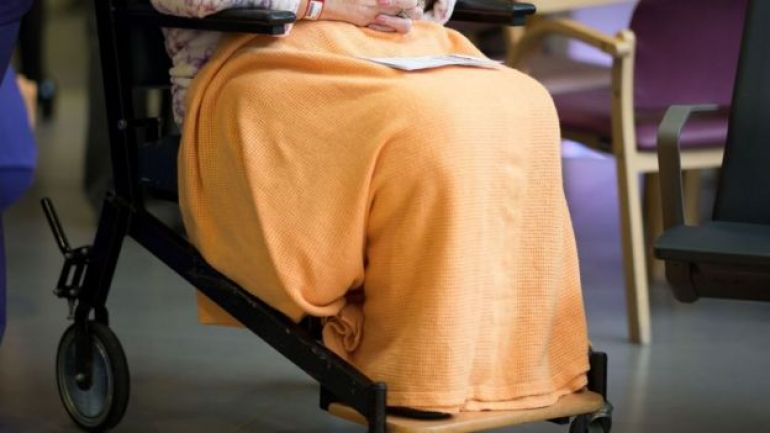 An elderly woman in wheelchair inside a hospital in Cardiff, UK