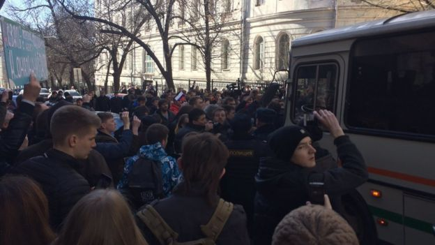 In this handout photo provided by Kira Yarmysh, Alexei Navalny press secretary, people block the way for police bus, where Alexei Navalny is kept in downtown Moscow
