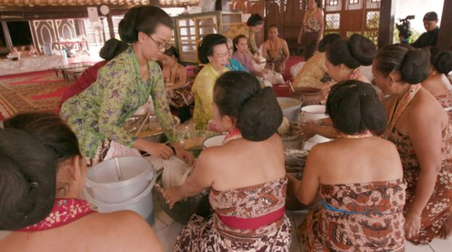 Women doing ceremonial cooking of sacred cakes.