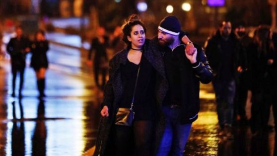 Young people leave from the scene of an attack in Istanbul, early Sunday