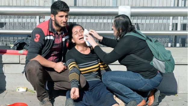 A woman is helped following an explosion in Turkey's capital Ankara (10 October 2015)