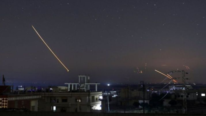 Missile fire seen over the southern Syrian city of Deraa on 10 May 2018
