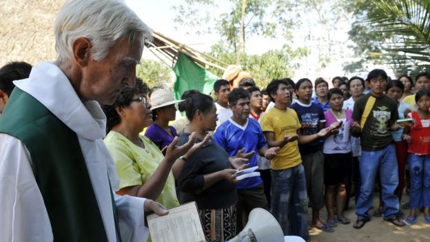 A priest giving Mass in the Amazon