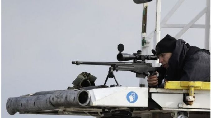 A sniper aims his weapon securing the area as President Barack Obama arrives at the Athens International Airport Eleftherios Venizelos on Tuesday, Nov. 15 2016