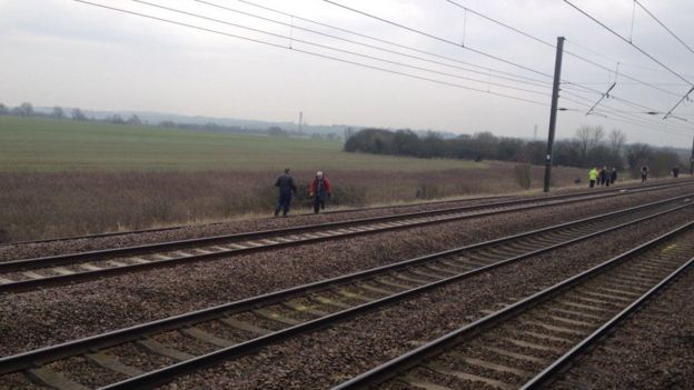 People on train track
