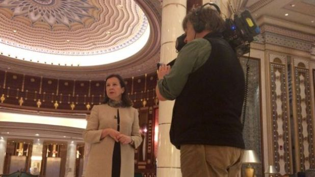 LyseDoucet and Philip Goodwin record a piece to camera in the glitzy Ritz Carlton lobby in Riyadh.