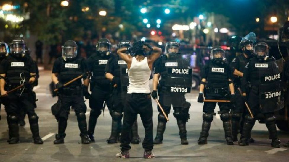 Police clash with protestors during demonstration in Charlotte, North Carolina, on 21 September