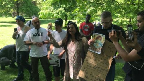 Protesters promoting conspiracies about vaccines and 5G attend a protest in St James's Park, London in May.