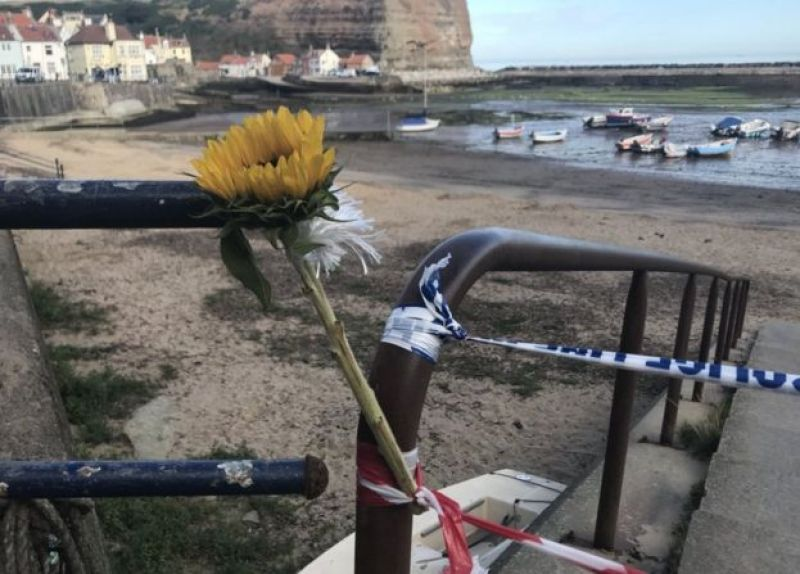Flower left at police cordon in Staithes