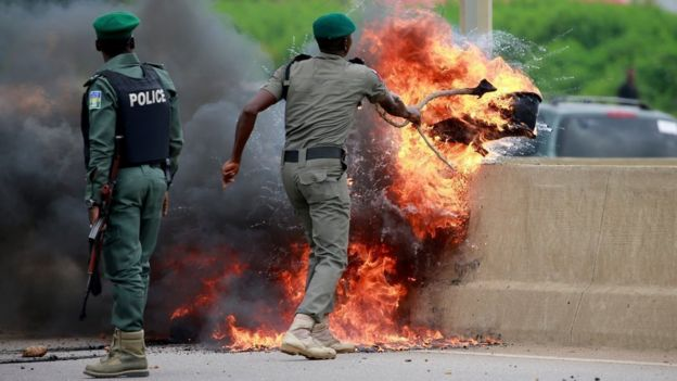 Police dealing with a fire in Lagos, Nigeria