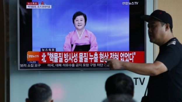 A North Korean TV presenter, watched here in the South, reads out the news