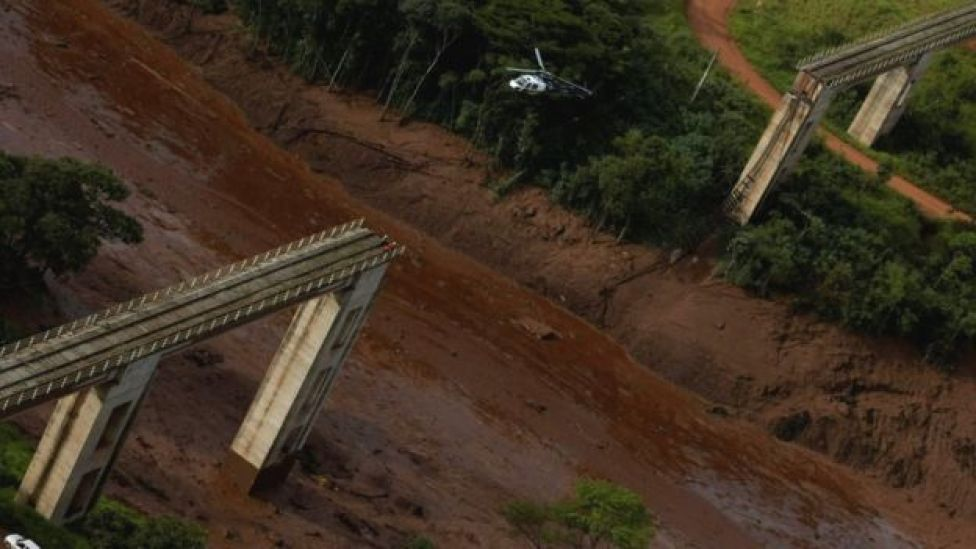 A helicopter flies over a dam owned by Brazilian miner Vale SA that burst, in Brumadinho, Brazil