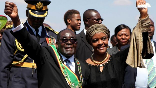 Zimbabwe President Robert Mugabe (L) and his wife Grace (R) greet supporters at a national Heroes Day rally in Harare, August 11, 2014