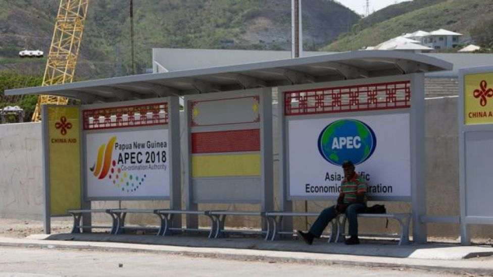 Chinese aid branding and APEC ads on a bus stop in Port Moresby