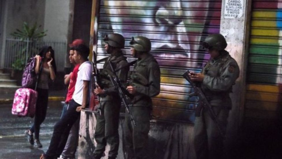 Armed soldiers stand guard in Caracas. Photo: 4 August 2018