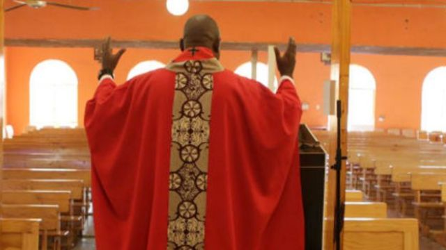 A priest in an empty church in South Africa