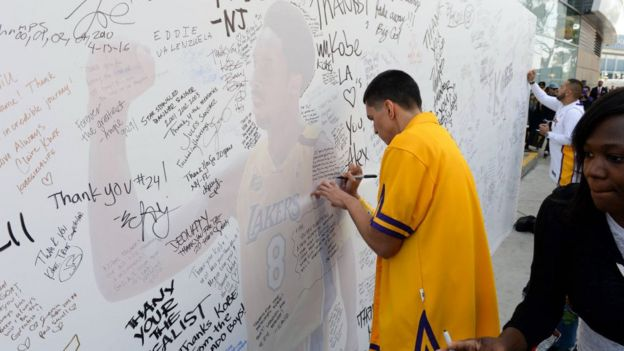 Fans write messages to Kobe Bryant at the Staples Center. Los Angeles. 13 April 2016