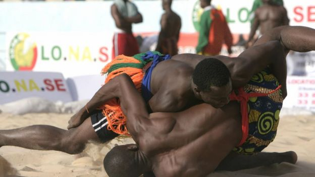 Two people wrestling at a tournament in Senegal - 2009