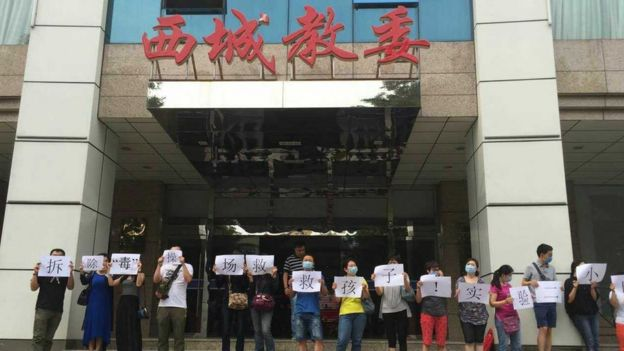 Parents protested in front of local education authorities demanding the school remove the toxic running track.