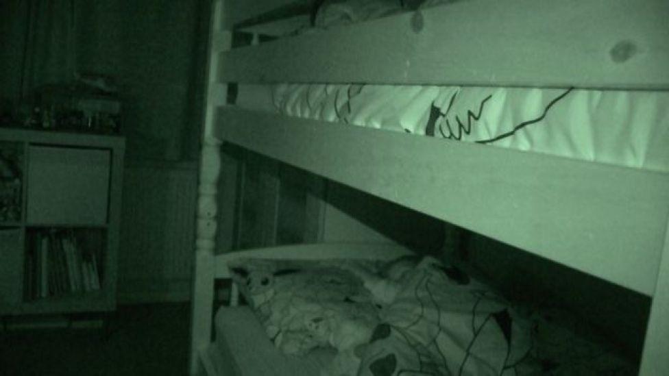 boys asleep in bunk beds