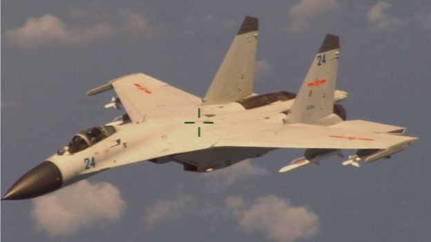 The Chinese jet fighter Shenyang J-11B, as seen from a US Navy P-8 Poseidon surveillance airplane on 19 August 2014.